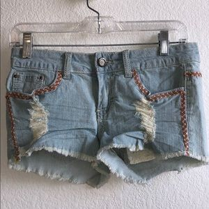 Embroidered jean shorts with lace pockets